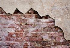 Rustikale Backsteinmauer mit Stuck Stockfotografie