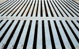 Rustikale Metalleinsteigeloch-Platte und Hintergrundfoto Lizenzfreies Stockbild
