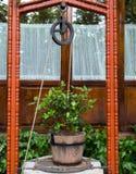 Rustikaler Brunnen Stockfotografie