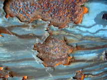 Rusting through. Rust coming through blue paint Royalty Free Stock Photos