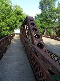He rusting arch of a road bridge. Over a small river in Coldwater, Michigan, USA Stock Image