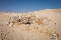 Rusting barbed wire and trash in the desert Royalty Free Stock Photos