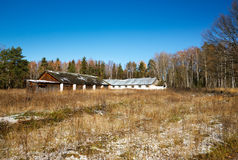 Rusting broken down farm house on rural Russia Stock Photo