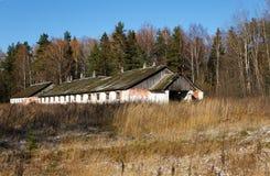 Rusting broken down farm house on rural Russia Stock Photos