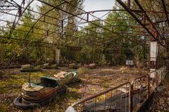 Rusting derelict bumper cars at Pripyat, Chernobyl Stock Photo