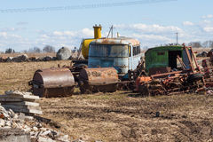 Rusting farm machinery in a field Royalty Free Stock Image