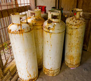 Rusting gas cylinders in a shed Royalty Free Stock Photo