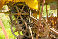 Rusting gears on an abandoned digger in the yukon. Old machinery used for excavating ore at a defunct gold mine in northern canada Royalty Free Stock Photography