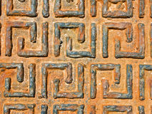 A Rusting Greek Drain Cover. The pattern and texture of an old greek drain cover, Greece Stock Images