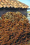 Rusting horseshoes stacked outside farriers workshop Royalty Free Stock Photos