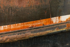 Rusting hull and peeling paint on an old deep sea fishing trawle. R Royalty Free Stock Photo