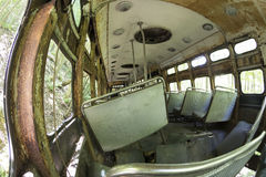 Rusting interior of abandoned trolley car Royalty Free Stock Photos