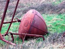 A bouy out of water. Rusting iron bouy in a field in County Sligo, Ireland stock photos