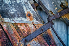 Rusting Iron and Weathered wood on old Rudder. Weathered rotted and peeling wood on an old ships rudder with Iron bolts Royalty Free Stock Photo
