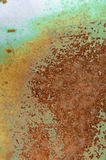 Rusting metal. Sprayed with different colours to expose the underlying layers Stock Photography