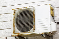 Rusting Metal Exterior Fitted Airconditioning Unit Mounted on W. Old vintage rusting metal exterior fitted airconditioning unit mounted on wall needing Stock Photo