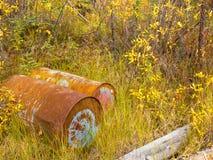 Rusting oil barrels being an environmental hazard Stock Photo