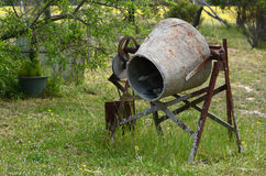 Rusting old cement mixer left to corrode. Royalty Free Stock Image