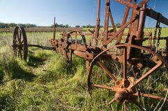Rusting Old Farm Plough. Vintage farm plough rusting in a field Royalty Free Stock Photo