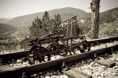 Rusting railroad bicycle next to rail tracks Royalty Free Stock Image