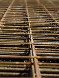 Rusting Rebar Mesh. Piles of rebar mesh lay in a constuction site Stock Photo