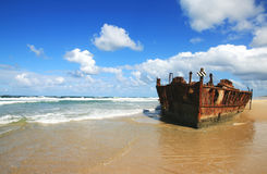 Rusting Shipwreck. The rusting wreck of the Maheno on the beach of the worlds largest sand island - Fraser Island stock photo