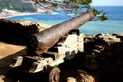Rusting Spanish cannon. At Tossa de Mar, Costa Brava Stock Photo