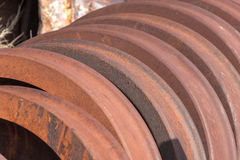 Rusting train wheels stacked in siding Stock Photography