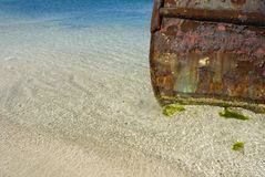 Rusting Tugboat. A beached tugboat rusting in the Caribbean royalty free stock image