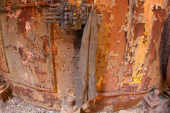Rusting vat with rag Stock Photo