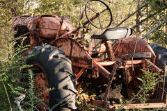 Rusty Abandoned Farm Tractor. This is a rusty old abandoned tractor that was once a very important tool for farming stock photo