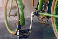 Green retro bike, standing on an asphalt street stock photo