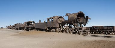Rusty and abandoned old trains at the Train Cemetery Cementerio de Trenes in Uyuni desert, Bolivia royalty free stock photography