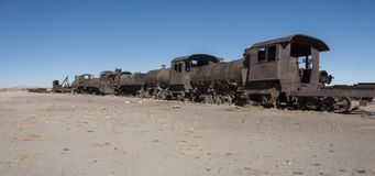 Rusty and abandoned old trains at the Train Cemetery Cementerio de Trenes in Uyuni desert, Bolivia stock images