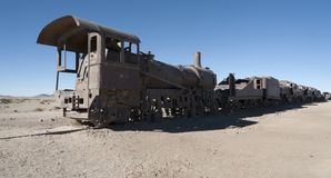 Rusty and abandoned old trains at the Train Cemetery Cementerio de Trenes in Uyuni desert, Bolivia royalty free stock photos