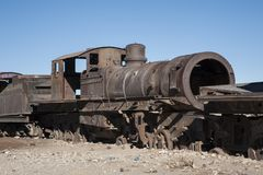 Rusty and abandoned old trains at the Train Cemetery Cementerio de Trenes in Uyuni desert, Bolivia royalty free stock image