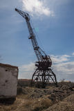 Rusty abandoned port crane in former Aral harbor. Kazakhstan Royalty Free Stock Photo