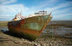 Rusty abandoned ship Stock Photo