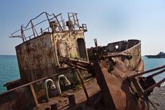 Rusty abandoned shipwreck on the beach in Sukhum, Abkhazia Stock Image