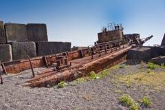 Rusty abandoned shipwreck on the beach in Sukhum, Abkhazia Stock Photos
