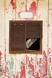 Rusty air vent in an old peeling door background Royalty Free Stock Photo