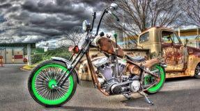 Rusty American chopper style motorbike and pickup truck Stock Photos