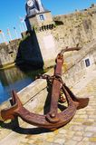 Rusty anchor. In front of the concarneau fortification in brittany Royalty Free Stock Images
