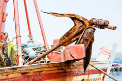 Rusty anchor on the boat Stock Photos