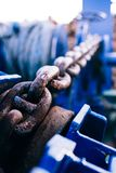 Rusty anchor chain on the bow. Part of mooring equipment. Blur. Close-up. Background royalty free stock image
