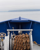 Rusty anchor chain and winch Royalty Free Stock Photo