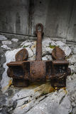 Rusty anchor. An anchor of an old rusty and secluded ship in a port Royalty Free Stock Image