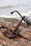 Rusty anchor on rock Royalty Free Stock Photos