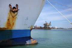 Rusty anchor on side of a ship Stock Photography