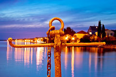 Rusty anchor view at blue evening Stock Image